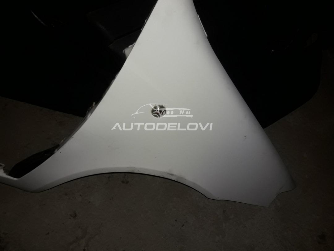 Fiat Punto trojka prednje desno krilo u beloj boji originsl
